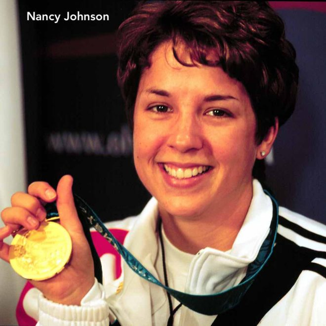 000916-F-8217W-007 Nancy Johnson is all smiles as she holds up the gold medal she won in the 10-meter air rifle competition at the 2000 Olympic Games in Sydney, Australia, on Sept. 16, 2000. Johnson's gold medal was the first gold medal awarded in the Sydney Games and the first gold for the U.S. Johnson is married to U.S. Army Staff Sgt. Ken Johnson, who is also on the U.S. Olympic shooting team. DoD photo by Tech. Sgt. Robert A. Whitehead, U.S. Air Force. (Released)